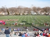 The crowd watches the boys'€™ 100 meter race in anticipation at the track invitational held at Bishop Miege High School April 5. Along with STA, many other high schools in the area participated in the meet. by Viridiana Hernandez