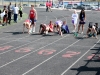 """Sophomore Hayley Baldwin prepares for the 100 meter hurdles at the track invitational at Bishop Miege High School April 5. """"I was doing a start,"""" Baldwin said. """"€œI did well!"""" by Viridiana Hernandez"""