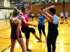 "Sophomore Alex Amey, from left, junior Katie Daniels, junior Camille Porterfield and junior Meghan Daniels joke during a break at the dance clinic at STA. ""This is the most girls we've had try out since I've been at STA,"" varsity dance member Katie Daniels said. by Viridiana Hernandez"