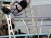 Freshman Caroline Armstrong dives at ILCs Feb. 11. Armstrong finished first overall in diving. photo by Mary Hilliard