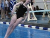 Freshman Caroline Armstrong dives at ILCs Feb. 11. Armstrong qualified for State, but cannot compete because she will be at the State dance competition. photo by Mary Hilliard