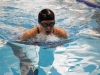 Freshman Kate Lowe swims breastroke during her 200 yard I.M. She finished fourth. Lowe also swam the 100 yard breastroke and finished fourth. photo by Mary Hilliard