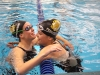 Junior Libby Hutchinson, left, hugs senior Darby Pedersen after getting her State cut in the 200 yard freestyle. Hutchinson also qualified in the 100 yard freestyle earlier in the season. photo by Mary Hilliard