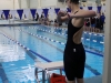 Junior Libby Hutchinson stretches before her 200 yard freestyle race. Hutchinson also swam on the medley relay and 400 yard freestyle relay at ILCs. photo by Mary Hilliard