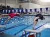 Freshman Kate Lowe, left, and junior Claire McCann dive off the blocks for their 200 I.M. Lowe finished fourth and McCann finished sixth. photo by Mary Hilliard