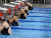 Sophomore Mia Schloegel prepares to start the backstroke length of the medley relay. Schloegel, along with freshman Kate Lowe and juniors Molly Winkler and Libby Hutchinson, won the relay. photo by Mary Hilliard