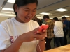 Senior Molly Woolery tries out the new iPhone 5c at the Apple Store on the Plaza Sept. 28. Woolery has had the iPhone 4s for a little over a year now and is looking to upgrade to either the iPhone 5c or 5s.