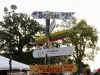 A sign pointing towards all of the different countries shows how far away each one is from Kansas City. The Ethnic Enrichment Festival lasted all weekend. Photo by Helen Krause