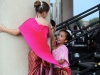 Young dancers laugh and play behind stage before they perform at the Ethnic Enrichment Festival Friday Augst 19, 2016. Almost every culture or country was represented by a performance. Photo by Helen Krause