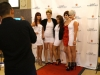 Hairstylists and makeup artists pose for a photo on the red carpet at KC fashion week. photo by Violet Cowdin
