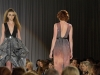 Two models from the same collection strut the runway at KC fashion week Sept. 24. photo by Vioet Cowdin