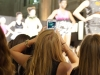 An audience member snaps a photo during a runway show at KC Fashion Week Sept. 24. photo by Violet Cowdin