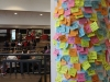 A column in the Commons stands covered with kind Post-It Notes March 30. The activity was sponsored by Peer Helpers as part of Kindness Month. photo by Maggie Knox