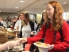 Junior Grace Girardeau pays the Peer Helpers for her pizza and cookies March 31. Kindness Month was sponsored by Peer Helpers. photo by Maggie Knox