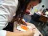 Lewer works on a still life of an orange pepper in Mrs. Blessen's room. Lewer also makes videos, and draws with graphite. photo by Violet Cowdin