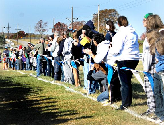 By Peyton Gajan. Fans line the course and anxiously wait for the runners.