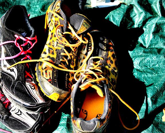 By Peyton Gajan. Sarah Vickery and Katie Hornbeck's Running shoes under the tent after the race.