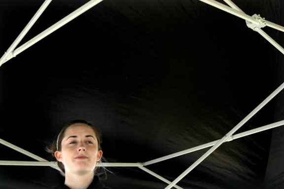 By Peyton Gajan. Kathleen Keaveny waits underneath St. Teresa's tent to find out how the team placed.