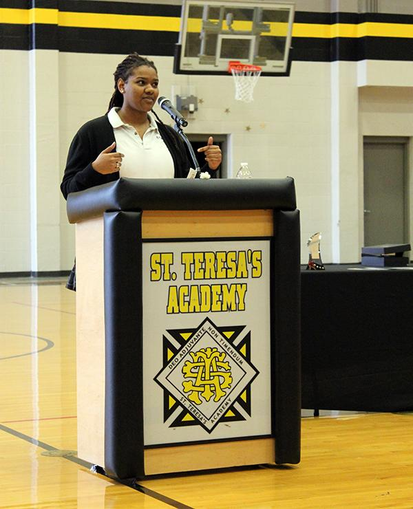 Senior Savaria Goodman speaks about her experience with service at the  Mother Evelyn O'Neill Service Award Ceremony March 8. photo by Bridget Jones.