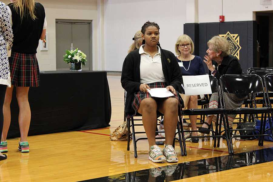 Senior Savaria Goodman prepares to speak about her experience with service at the  Mother Evelyn O'Neill Service Award Ceremony March 8. photo by Bridget Jones.