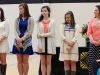 From left, seniors Gracie Fleming and Sydney Hunter, junior Kellie O'Toole, freshman Gabrielle Pesek and junior Lauren Ryan stand during the Mother Evelyn O'Neill Award Ceremony March 10. Each of the girls was nominated for the award by members of the STA community as recognition for their service to the dear neighbor. photo by Maggie Knox