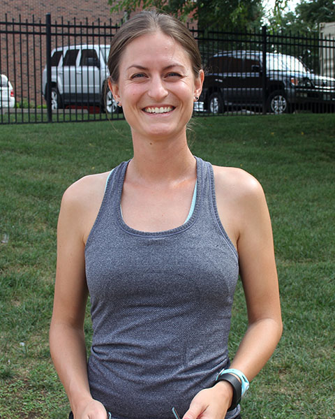 Sarah Flogel poses for a picture during cross country practice. Flogel is an assistant coach for cross country. photo by Paige Powell