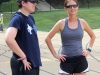 Cross country coaches Andrew Boland and Sarah Flogel converse at cross country practice Aug. 25. photo by Paige Powell