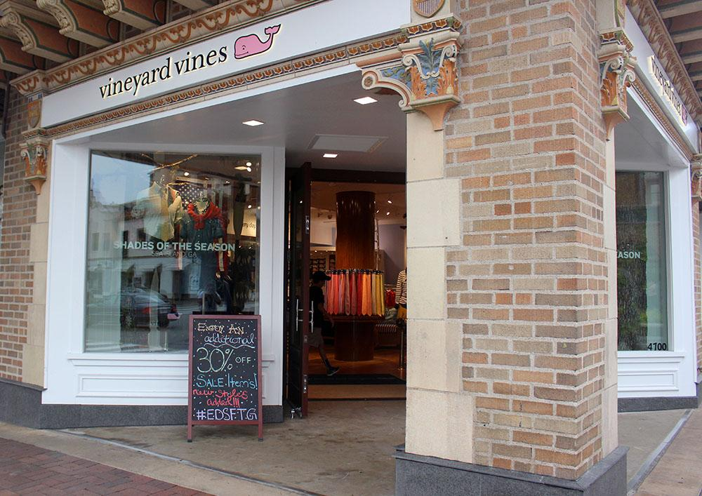 The storefront of Vineyard Vines displays a sign for items on sale. This Vineyard Vines store is new to the Country Club Plaza. photo by Kat Mediavilla