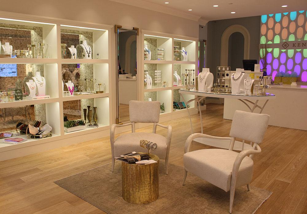 Inside Kendra Scott is a small sitting area surrounded by numerous display cases of jewlry. This store is new to the Plaza. photo by Kat Mediavilla