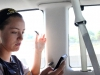 "STA senior Erin Farmer checks her Twitter and eats a Cosmic Brownie while on the way to Tiffany Hills Park Sept. 18. Farmer describes herself as the ""mom"" of the team."