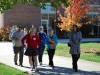 Junior Liz Barton leads her group through the quad. The Open House only took place in the Windmoor and Donelly buildings.