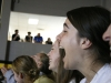 Senior Kristina Coppinger laughs at Spirit club's video at the pep rally Sept. 25. photo by Anna Hafner