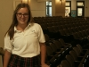 Senior Meg Rohr, leader of the Spirit Club, stops for a picture in the auditorium. photo by Cassie Hayes