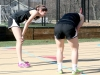 Sophomores, Katie Grasse, left, and Journey Eubank, catch their breath after finishing the 400 meter dash at the STA home meet on April 5. STA won their home meet and beat Sion and University Academy. by Giggy Reardon