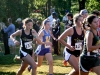 Senior Emily Laird, right, and Junior Emma Kate Callahan run in the Rim Rock Farm Classic cross country meet. There were 25 St. Teresa's runners participating in the meet. photo by Kate Scofield