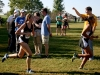 Freshmen Aryanna Wyatt, right, and Grace Laird  run in the Rim Rock Farm Classic Cross Country meet on Sept. 27. Wyatt set a new personal record  of 21:50 in the varsity race. photo by Kate Scofield