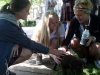 Seniors, from left, Hallie Ryan, Mary Grace Campbell, and Andie Round crouch down to pet Machella Dunlea's puppy. Dunlea brought her dog to school to visit her advisory during senior farewell parties. photo by Cassie Hayes