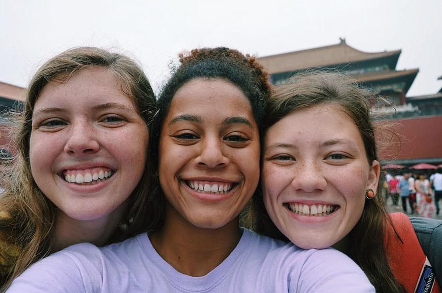 Sarah, left, Jewell Allen, and Rielly smile for a picture during their debriefing when they went to the forbidden city in Beijing. The girls were on her team, and are from Alabama and Indianapolis. photo courtesy of Jewell Allen