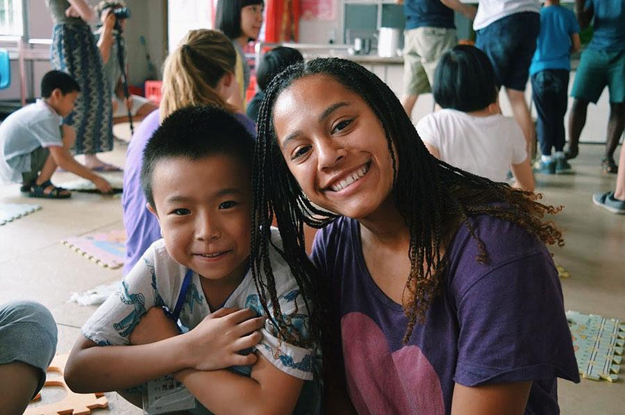 STA senior Jewell Allen, right, smiles with Tony, a boy at a VBS in Fuzhou, China. photo courtesy of Jewell Allen