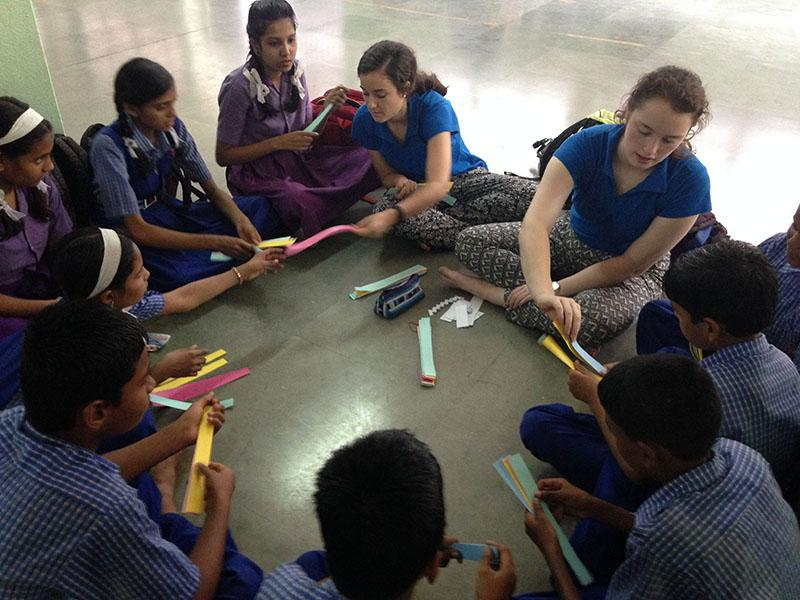 Meredith Raymer and her community service group in India help children attending a government school with spoken English. photo courtesy of Meredith Raymer