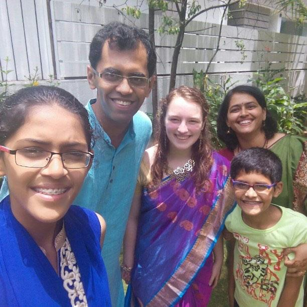 Senior Meredith Raymer smiles with her host family in India after a neighbor's wedding. photo courtesy of Meredith Raymer