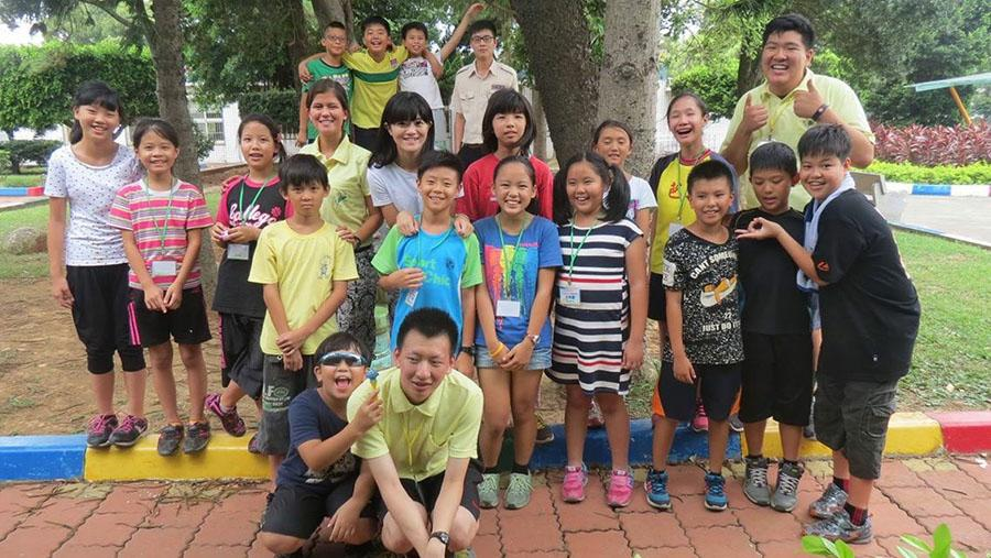 Senior Sarah Cigas poses with the kids in the class she taught for two weeks. She is also with her teaching partners Timothy Song and Benjamin Yin. photo courtesy of Sarah Cigas