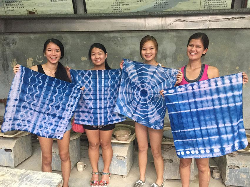 American students Charlai Breeding, left,  Cynthia Sun, Emily Chao and Sarah Cigas hold pieces of tie dyed fabric while learning about the Haka culture in Taoyuan, Taiwan. photo courtesy of Sarah Cigas