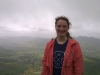 """Senior Meredith Raymer smiles for a photo atop Sinhagad Fort. """"The fort has historical importance to the area, a famous fighter died in battle there,"""" Raymer wrote. photo courtesy of Meredith Raymer"""