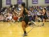 Senior Ryan Wilkins dribbles the ball at the varsity basketball game against Notre Dame de Sion Jan. 29. Wilkins has signed to play basketball at Bradley University. photo by Kat Mediavilla