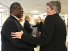 Dr. Liz Baker shakes hands with Mayor Sly James at the Year of the Woman assembly Feb. 1. photo by Paige Powell