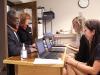 Mayor Sly James and President Nan Bone talk to Help Desk volunteers Feb. 1. photo by Paige Powell