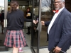 Mayor Sly James holds the door for students entering the Goppert Center Feb. 1. photo by Paige Powell