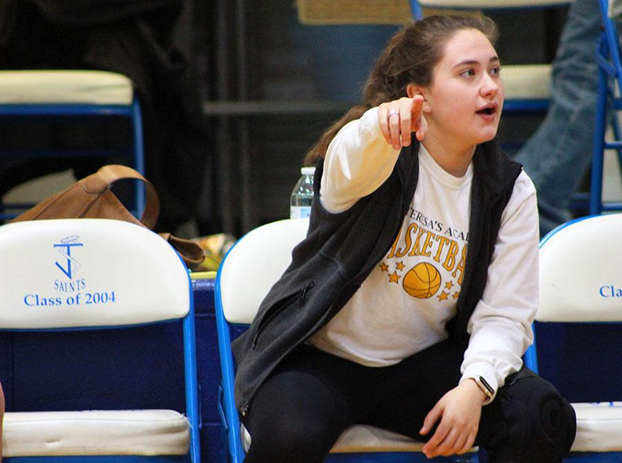 Senior Sophia Cusumano points to her players on the court at St. James Feb. 14. photo by Bridget Jones.