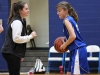 Senior Sophia Cusumano practices with St. Peter's seventh grader Molly Lombardi during halftime at St. James Feb. 14. photo by Bridget Jones.